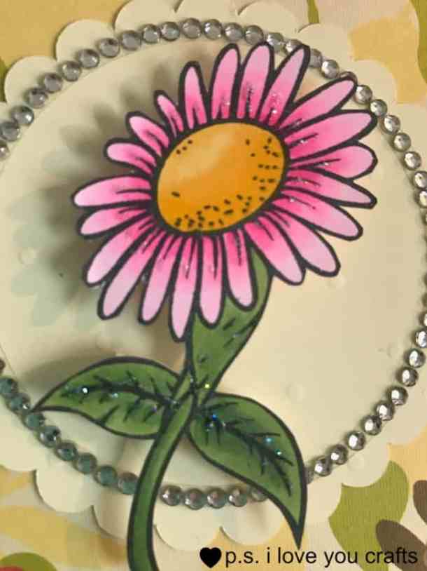 Daisy Card using a rubber stamp from Simply Stamps. It was colored with Copic Markers, a simple design, rhinestones, and glitter to make a pretty all occasion card.