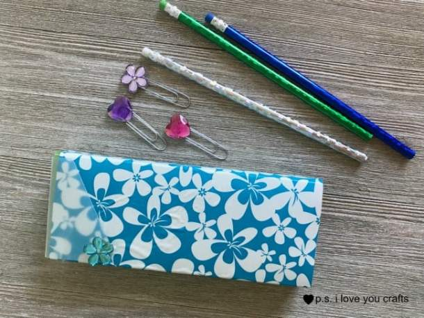 Use Duck Tape Sheets to cover a pencil case and large rhinestones to make a Back To School Craft.