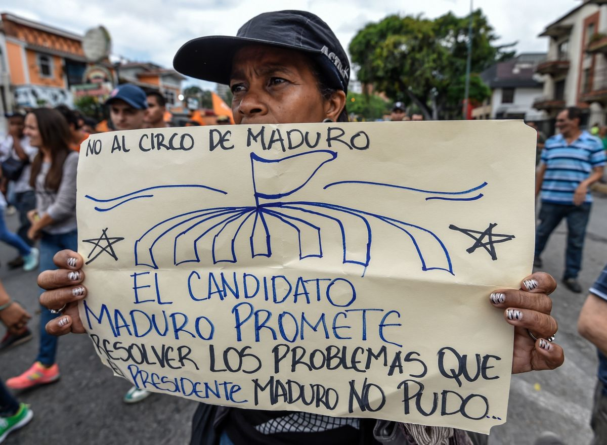 """""""No to the Maduro circus. The candidate Maduro promises to solve the problems that the President Maduro could not."""" An opponent of Venezuelan President Nicolas Maduro demonstrates in front of the Organization of American States offices in Caracas on May 16th, 2018."""