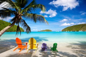 colorful andirondack chairs at a Caribbean beach