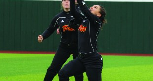 Softball team plays doubleheader