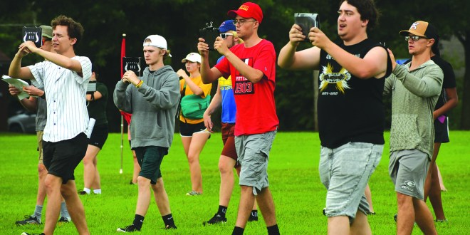 Marching band prepares for football season during band camp