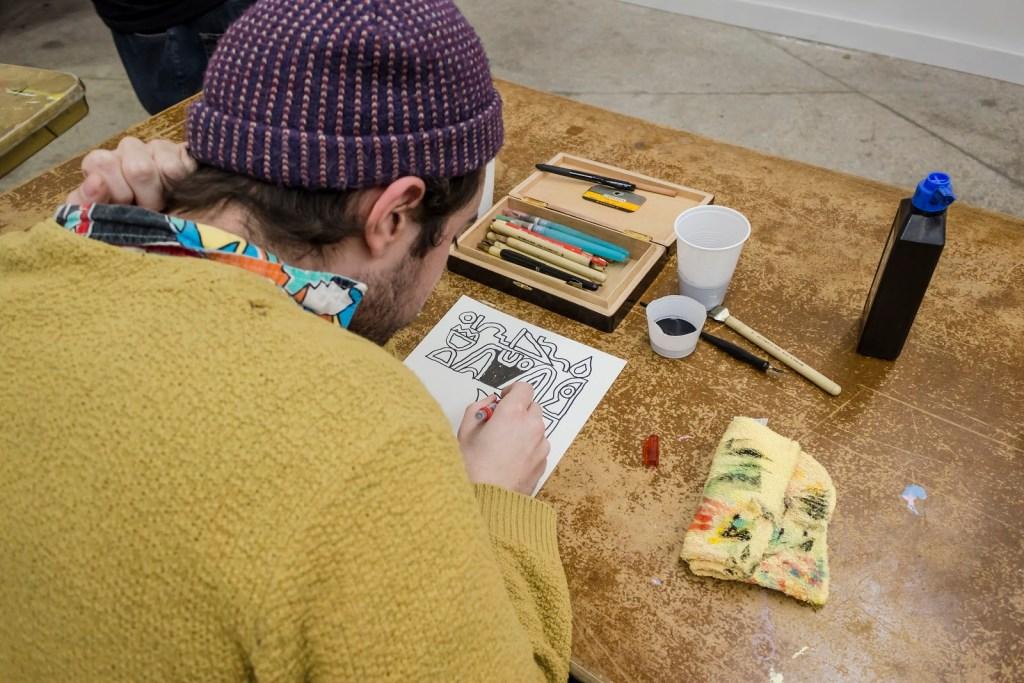 Artist Spencer Pullen drawing at Hot Hands 2017.