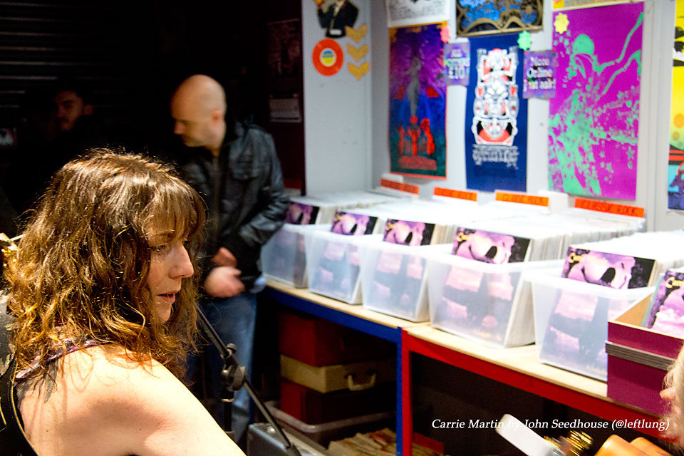 Carrie Martin ready to perform in the Psychotron records shop with copies of Seductive Sky in all the racks