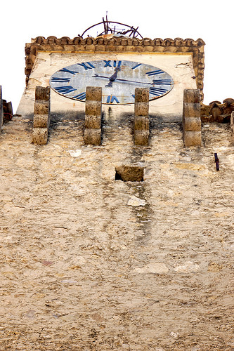 ancient stone clock photo