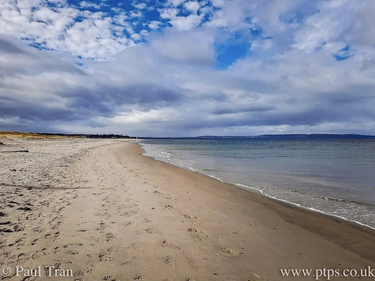 bright day with cloudy sky at the beach
