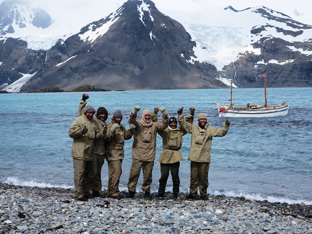 The-crew-of-Alexandra-Shackleton-onshore-at-South-Georgia-cheer-their-successful-completion-of-leg-1-of-their-historic-re-enactment.-Image-Jo-Stewart-Shackleton-Epic