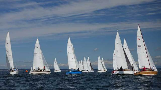 The starting line got crowded with 17 boats fighting for a spot. Photo by Steve Scharf.