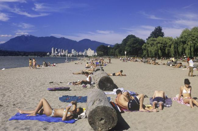 people-sun-tanning-on-kitsilano-beach--english-bay--vancouver--british-columbia--canada--125970533-596290c83df78cdc68bade98.jpg