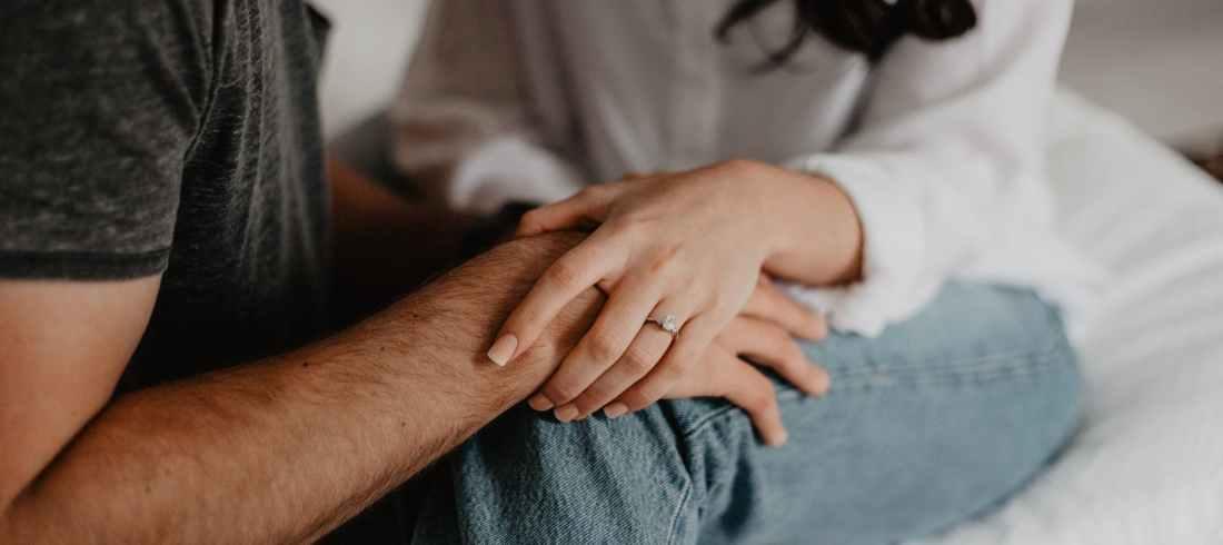 woman holding man s hand