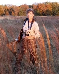 Carol Clark in a field of tall grasses