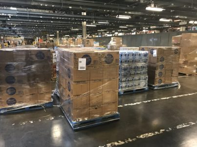 pallet wrapped in plastic sitting in a warehouse