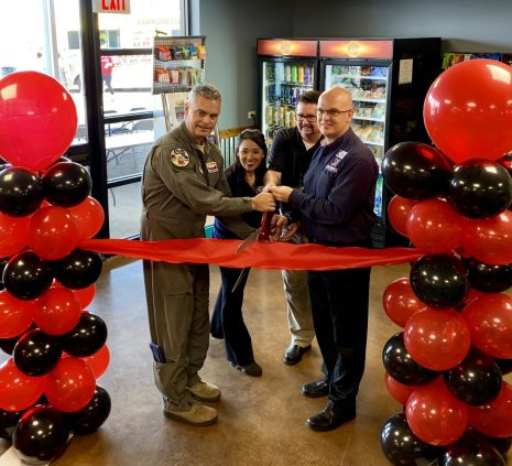 Brig. Gen. Andrew McDonald, commander of the 162nd Wing joined Exchange General Manager Mikel Hunter, Service Businesses Manager Maecelle Cummings and Ace Vending Accounting Representative Mike Pearce in cutting the ribbon at a grand opening ceremony of a micro market at the Tucson Air National Guard Base Aug. 6. (Photo courtesy of Capt. Erika Jaramillo, 162d Wing Public Affairs)