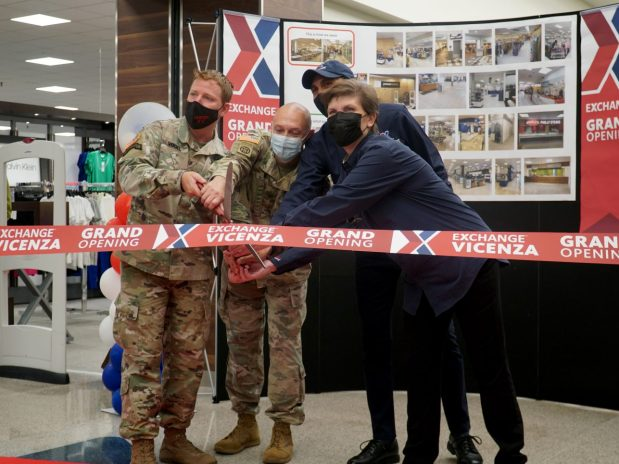 USAG Italy command and Exchange associates cut the ribbon on the updated Exchange a Vicenza.
