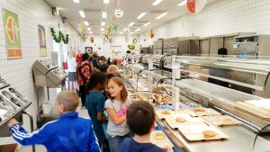 The school lunch program provides 3 million meals to military children overseas including these students at Netzaberg Elementary School, Germany.