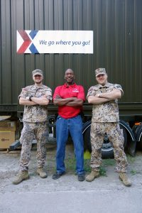 Soldiers pose with an Exchange associate.