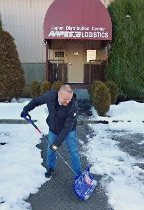 Japan Area DC  Warehouse Operations Supervisor Victor Mohr  uses gloves and the appropriate snow removal equipment when clearing a safe pathway to the distribution center.