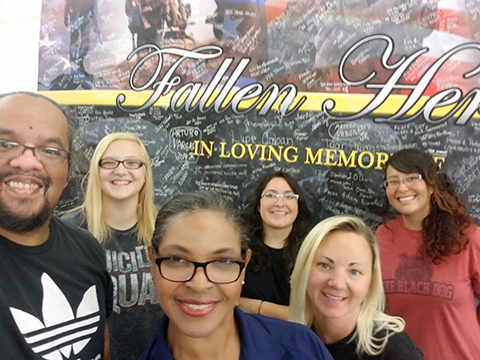 Main Store Manager Paula Bradford, front, and visual merchandisers at Fort Bliss created a display honoring Warfighters lost in action.