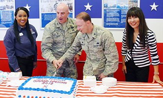 Store Manager LaToya Harris, left, and General Manager Shinobu Matsui, right, join 374th Airlift Wing Commander Col. Kenneth Moss and 374th MSG Commander Col. John Winkler to cut the ceremonial cake marketing the grand re-opening of the Yokota AB main store.