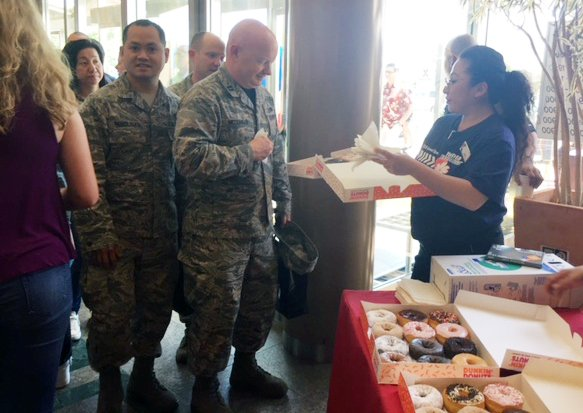 Food Concept Manager Toshie Chiba hands out samples of doughnuts at the grand re-opening ceremonies of the Yokota AB Exchange.