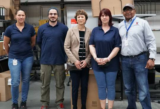 Executive Vice President and Chief Logistics Officer Karen Stack, center, with, left to right, forklift operators Casandra Kees, Mustafa Cengiz and Stefanie Birklein; and Roger Wright, warehouse foreman for the business-to-business division at Germersheim.