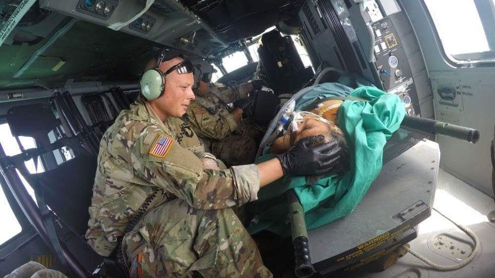 Dr. Benjamin Stork, who was recently  named the Army's Flight Surgeon of the Year, tends to person injured during one of the hurricanes in Puerto Rico last fall.