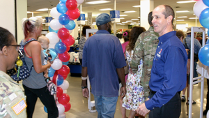 General Manager Jeff Hyatt welcomes shoppers to the newly renovated Exchange at Fort Huachuca, Ariz.