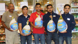 Exchange associates help load turkeys into the freezer at the Al Udeid Blatchford-Preston Complex Exchange in Qatar. From left: Dennis Dawson, store manager; Jofre Palinlin, inventory control associate; Prakash Rijal, inventory control associate; Kutub Uddin, sales associate; and Prem Khadka, customer service leader.
