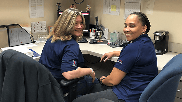 Mindy Whitman, left,  logistics assistant at JB Langley-Eustis, works with fellow military spouse Yajaira Sanchez. Sanchez, a softlines stocker, is married to a Coast Guard member.