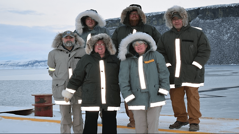 Frank Partridge, Thule store manager; Timothy Barba, shift manager; Osa Fatuesi, assistant store manager; Bill Miele, shift manager; Deborah Mills, barber; and Phyllis Blackburn, store manager, are serving at the Thule Exchange in Greenland.