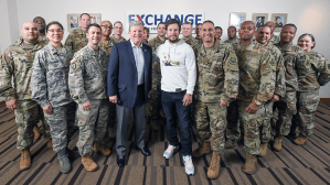Actor Mark Wahlberg stands with Exchange Director/CEO Tom Shull and Soldiers and Airmen assigned to HQ.