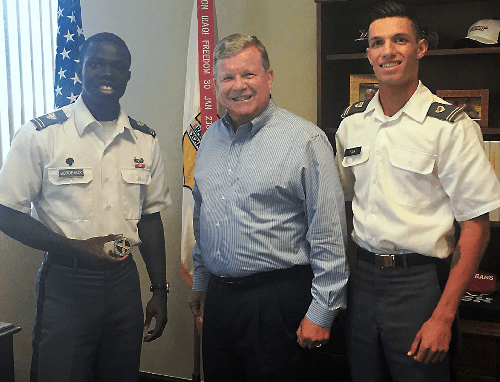 "Director/CEO Tom Shull with USMA Cadets Thomas ""TJ"" Bordeaux, left, and Christian ""CJ"" Falk."