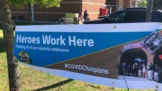 """Command put up """"Heroes Work Here"""" banners outside essential services, including the Exchange."""