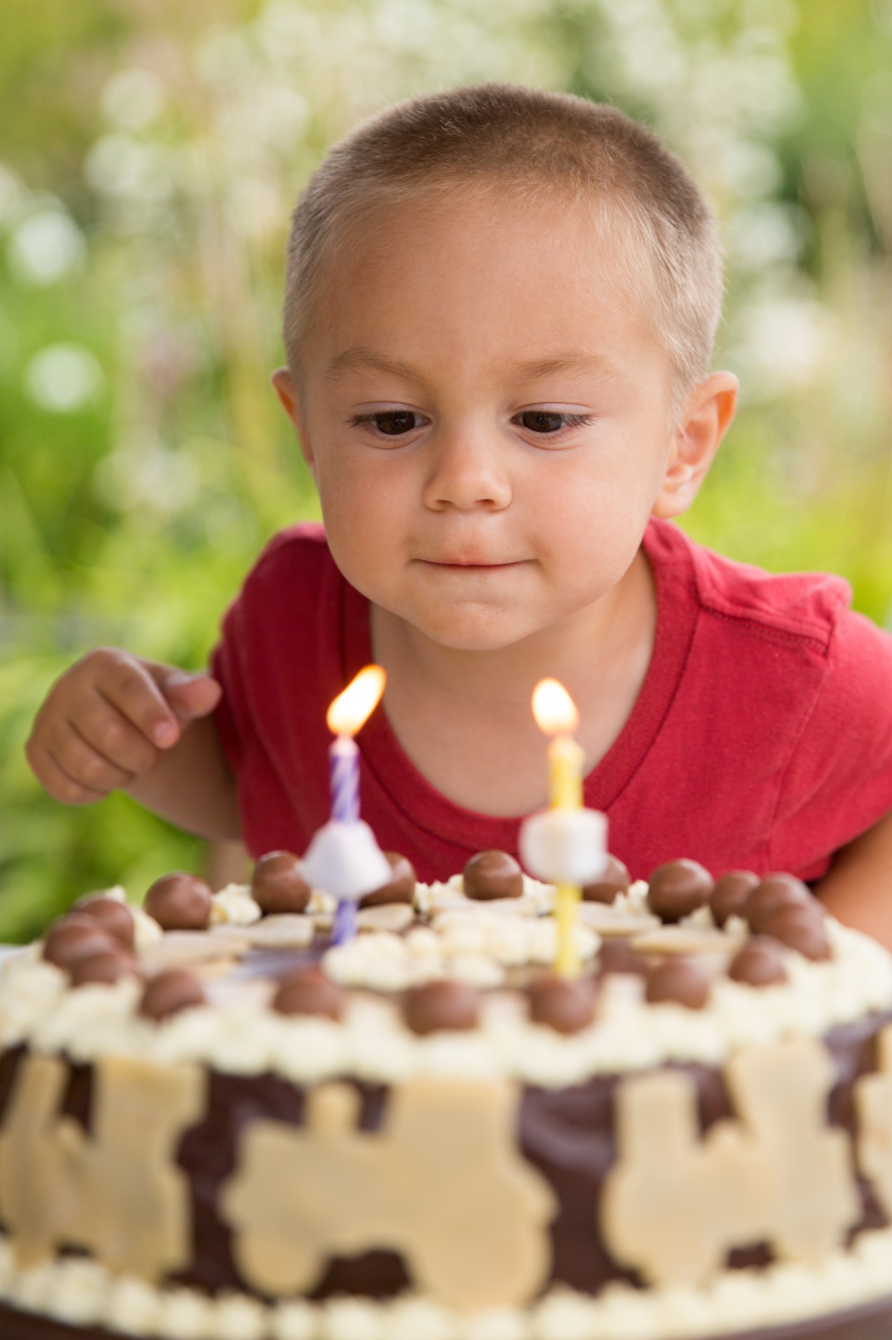 Boy Blowing Out Candles Free Stock Photo Public Domain