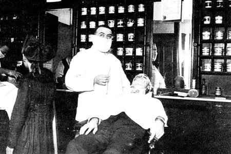 A photo of a barber wearing a mask