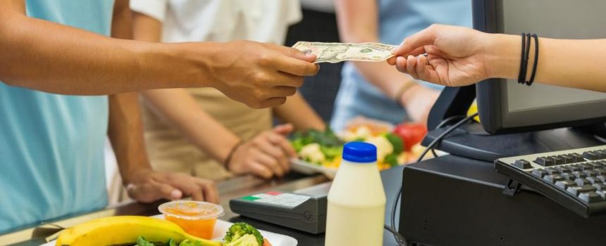 A student purchasing lunch in a cafeteria