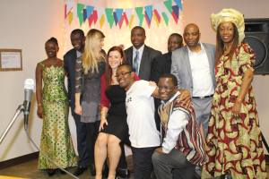 Frank Magass, standing second from right, and Ngozi Oleru, standing far right, helped lead the fundraising for Ebola relief.