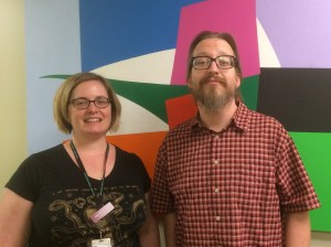 Nurse Practitioner Meredith Kriebel treats clients at Public Health's clinic at Navos, and Jeremy Lemoine of REACH provides outreach case management