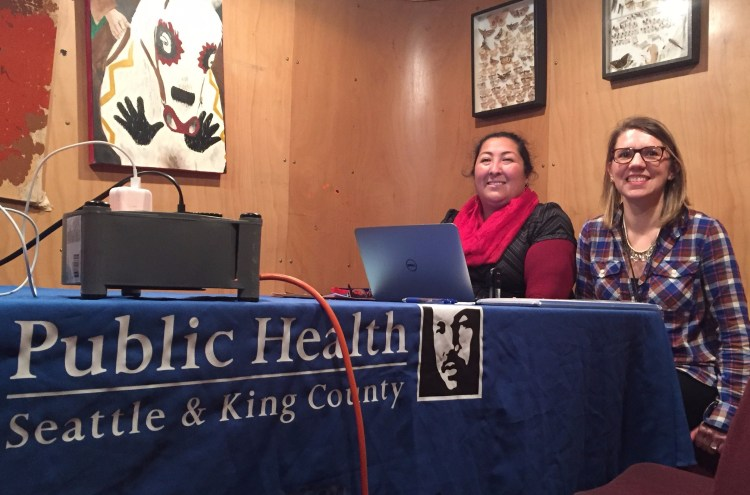 Health insurance Navigators Carmen Olvera and Jennifer Covert bring laptops and answer questions at enrollment events across King County