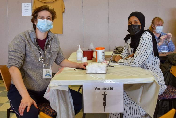 Two volunteers at Skyway clinic