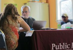 Javier Amaya of Access and Outreach helps a South Park client enroll in health insurance.