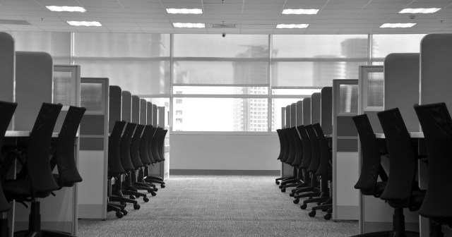 Empty office with cubicles and chairs