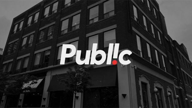 """Black and white image of our office at 26 Soho Street, Toronto, with the word """"Public"""", our logo, layered over top."""
