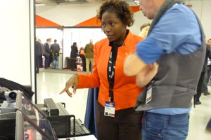 Odette Campbell reviewing software systems at the Radiodays Exhibition