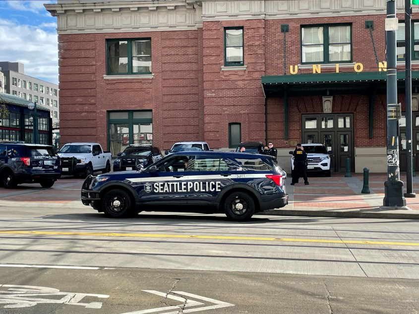 Seattle Police Department cruiser parked outside of Union Station in Seattle's International District