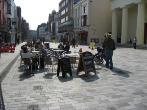 A shared space street at New Road Brighton, used by cafes as well as traffic