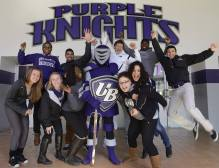 University of Bridgeport athletes pose in the lobby of Hubble Gymnasium with the Purple Knight mascot. UB has 13 NCAA Division II varsity sports and participates in the East Coast Conference. As well as varsity athletics, UB allows all students to get involved with nine co-ed intramural sports.