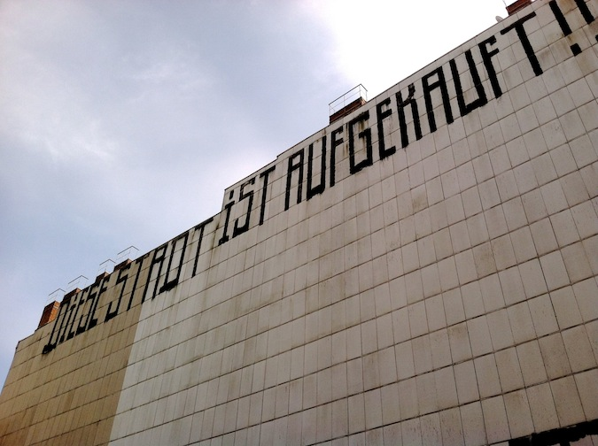 "Writing on a building on Schönhauser Allee, Berlin, saying, ""Diese Stadt ist aufgekauft"" (this city is bought out). © Virag Molnar"