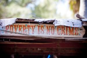 """POVERTY IS NO CRIME"" - Sign decorating a house in Virginia Key, Miami, Florida © Thomas Hawk   Flickr"