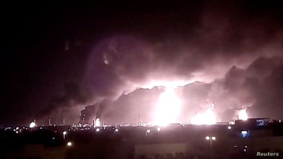 Fires burn in the distance after a drone strike by Yemen's Iran-aligned Houthi group on Saudi company Aramco's oil processing facilities, in Buqayq, Saudi Arabia September 14, 2019 in this still image taken from a social media video obtained by REUTERS     ATTENTION EDITORS - THIS IMAGE HAS BEEN SUPPLIED BY A THIRD PARTY. MANDATORY CREDIT. NO RESALES. NO ARCHIVES.